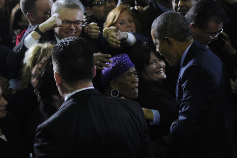 After his speech, President Barack Obama, greets admirers along a rope line inside the hall.