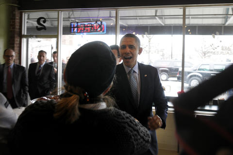 President Barack Obama, enters Cafe Beauregard, a New Britain restaurant, for a quick lunch. Walking through the door behind him are Tom Perez, Sec. Of Labor, and Vermont Gov. Peter Shumlin. Gov. Dannel P. Malloy, is also present, but partially hidden behind the clerk.