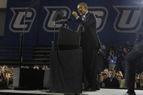 With a banner of CCSU in the background, President Barack Obama, delivers his speech.