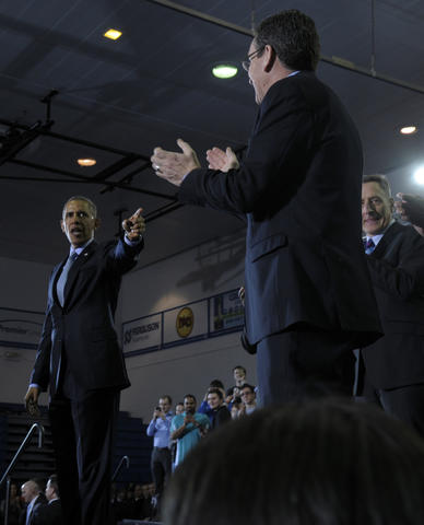 While accepting applause and after delivering his speech,President Barack Obama, thanked Gov. Dannel P. Malloy, and pointed at him. Vermont Gov. Peter Shumlin, looks on at right.