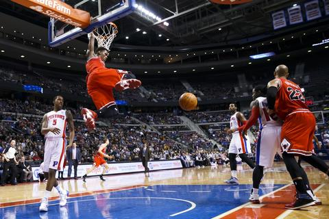 Jimmy Butler dunks against the Pistons in the first half.