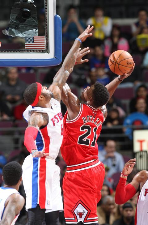 The Pistons' Josh Smith scores against Jimmy Butler during second-period action.