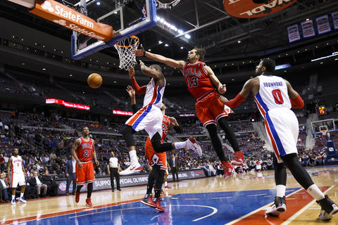 Joakim Noah blocks a shot by the Pistons' Greg Monroe in the fourth quarter.