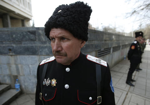 Pro-Russian Cossacks stand guard at the Crimean parliament building in Simferopol.