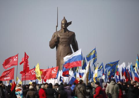 People hold a rally in the Russian southern city of Stavropol, in support of the people of Crimea, on March 7.