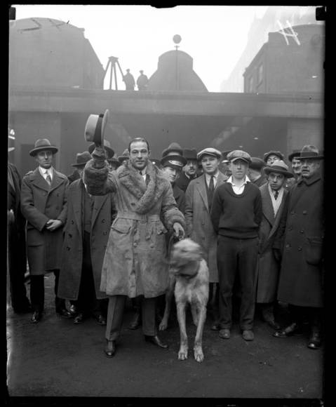 Rudolph Valentino with his Irish Wolfhound, Centaur Pendragon. According to the original caption, Valentino is with Mr. Karzas, manager of the Trianon Ballroom. Following Valentino's death in 1926, a Chicago memorial was held at the Trianon Ballroom (located in the Woodlawn neighborhood).