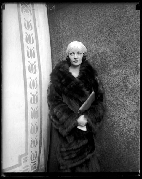The second Mrs. Rudolph Valentino in Chicago, March 20, 1926. Valentino's second wife name has a complicated history: she was born Winifred Shaughnessy, was formally adopted by her stepfather to become Winifred Hudnut, and later used the stage name Natasha Rambova.