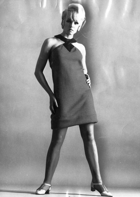 """SLEEK CHIC NEW YORK: Chic is the word for this zippy, young shift modeled by actress Joey Heatherton. The short dress with its surge of electric stripes and leather trim is one of the ""Leather Girls"" designed by Don Simonelli for Mia's fall collection."""