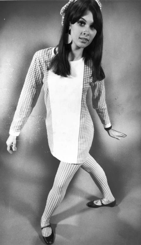 """Abstract houndstooth checks of stretch nylon are fashioned into tights with fencer-front tunic top plus cap ($20) at Cheetah boutique."""