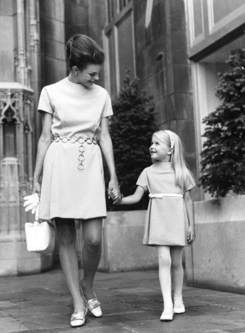"""Mother chose not to accent an empire waist in her dress No. 8383, instead used a smart chain belt at the normal waistline. Daughter's dress, identically styled, is made from pattern No. 8384."""
