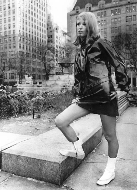 """Dressed in British designer Paul Blanche's ""Raingear,"" a flared hipster miniskirt and Ike jacket, model Lorna McDonaugh brightens the scene at the plaza at 59th St. Such outfits could make rainy days popular."""