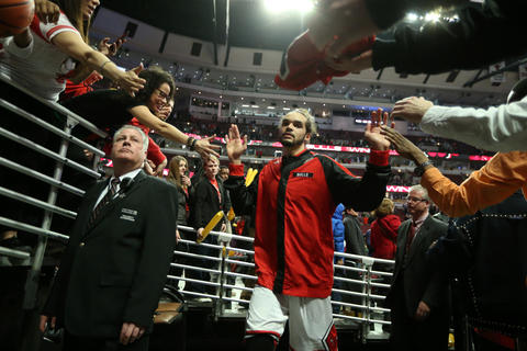 Joakim Noah is congratulated by fans as he heads for the locker room after beating the Rockets at the United Center.