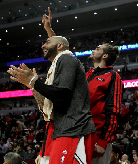 Carlos Boozer and Joakim Noah celebrate on the bench late in the fourth quarter.