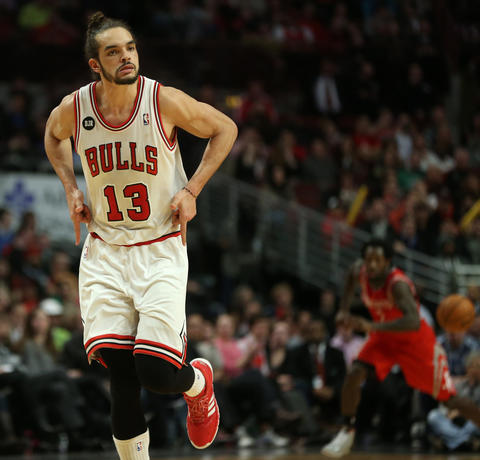 Joakim Noah celebrates after hitting a jumper in the second half.