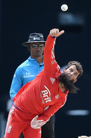 English bowler Moeen Ali delivers a ball during the first One Day International match bewteen West Indies and England at the Sir Vivian Richard Stadium in St John's, February 28, 2014. AFP PHOTO/Emmanuel DunandEMMANUEL DUNAND/AFP/Getty Images ORG XMIT: 474156149