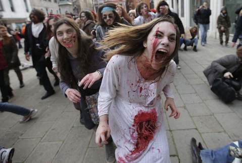 "People dressed as zombies take part in a ""Zombie Walk"", part of the Venetian Carnival, in Venice February 15, 2014."