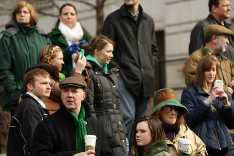 Crowds watch as members of the Chicago Journeymen Plumbers Local Union 130 pour green dye into the Chicago River as part of the annual St. Patrick's Day festivities.