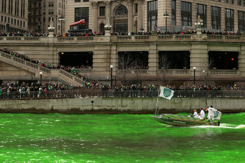 Members of the Chicago Journeymen Plumbers Local Union 130 pour green dye into the Chicago River as part of the annual St. Patrick's Day festivities.