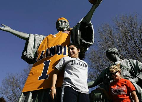 Illini fans gather around the Alma Mater statue on campus to have their picture taken after an alumnus placed an over-sized jersey and ball on the statue. The celebration was in honor of Illinois meeting North Carolina for the NCAA Men's Division I Basketball Championship on April 4, 2005.
