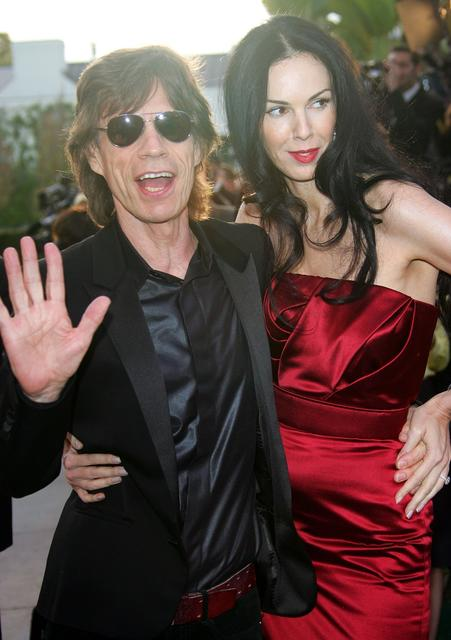 Singer Mick Jagger and L'Wren Scott arrive at the Vanity Fair Oscar party at Morton's in 2006 in West Hollywood. The two had been romantically linked since 2001.