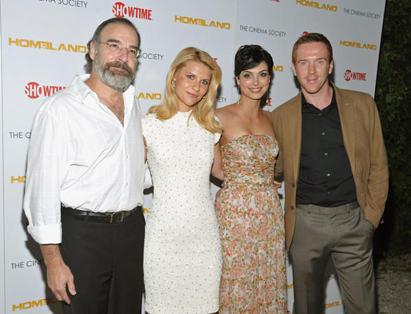 Claire Danes, second from left, wears a L'Wren Scott dress to Showtime & Cinema Society `Homeland¿ Premiere in 2011.