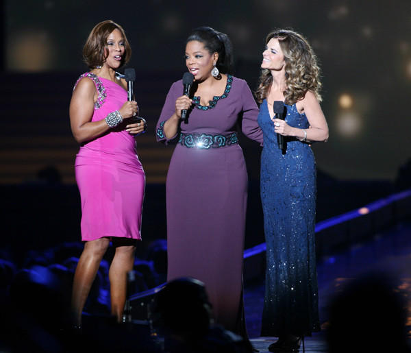 Oprah Winfrey, center, wears a custom L'Wren Scott dress as she speaks on stage during the taping of the third to last Oprah Winfrey Show at the United Center in Chicago in 2011.