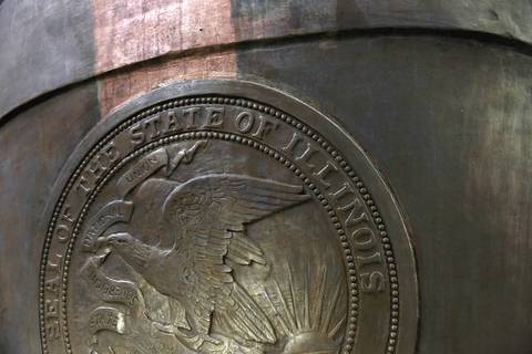 The Seal of the State of Illinois appears on the back of the sculpture.