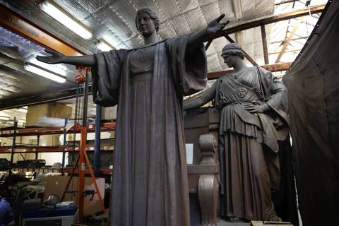 Two completed parts of the Alma Mater sculpture, Alma Mater, front, and Athena sit in the work space at Conservation of Sculpture and Objects Studio Inc., in Forest Park,