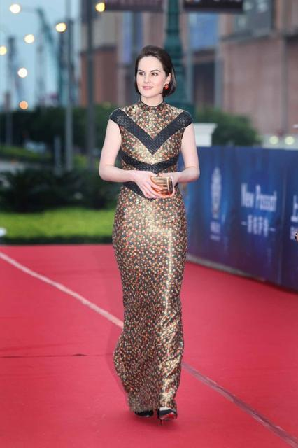 Actress Michelle Dockery wears a L'Wren Scott dress to the 2013 Huading Awards ceremony on Macau on Oct. 7, 2013.