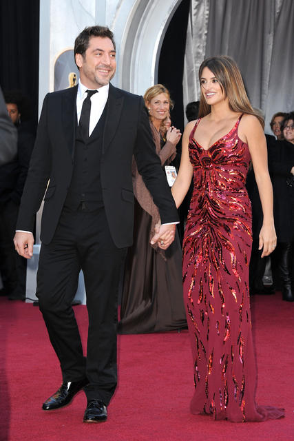 Penelope Cruz, alongside Javier Bardem, shows off her post-baby body in Scott's low-cut, sleeveless, firecracker-red sequin gown at the 2011 Oscars.