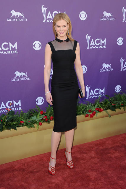 When Scott launched her own clothing line in 2006, it was originally called Little Black Dress, reflecting her desire to design the perfect black dress. Well, this design worn by Kidman to the ACM Awards might just be it, with an illusion neckline, point collar and hem that fell just past the knee. Scott was known for her sheath dresses, and this one, like most of the ones she created, hugged every curve.