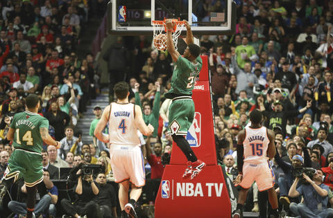 Jimmy Butler dunks on a breakaway against the Thunder during the second half.
