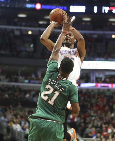 The Thunder's Kevin Durant shoots over Jimmy Butler during the second half.