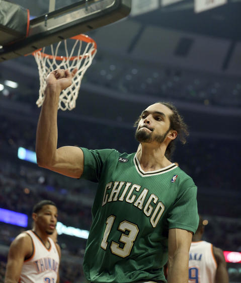 Joakim Noah reacts after getting fouled during the first half.