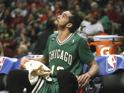 Joakim Noah looks up at the scoreboard, during the second half.