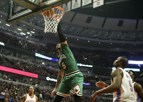 Carlos Boozer dunks against the Thunder in the first half.