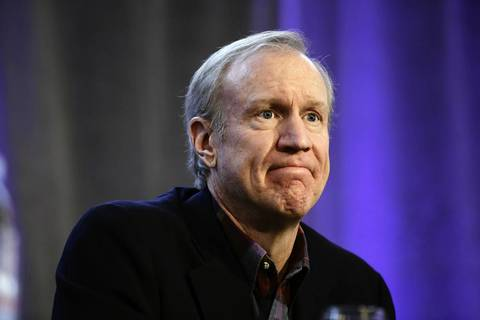 Businessman Bruce Rauner listens during a forum for Republican candidates for governor in Mount Prospect