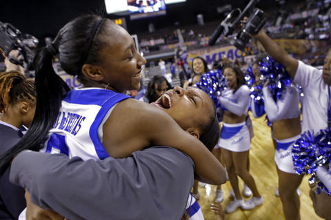 Staff Photo Of The Week: March 15-March 21, 2014   Hampton's Malia Tate-DeFreitas, left, and Bayley Coleman-Cox, center, celebrate after defeating Coppin State 50-47 during Saturday's championship game of the 2014 MEAC tournament at Norfolk Scope Arena.