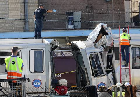 Police and CTA workers investigate the dimensions of the crash after two CTA Blue Line trains collided at the Harlem stop in Forest Park.
