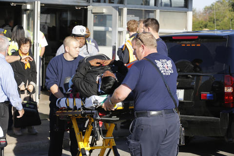 A victim is transported from the scene of Blue Line train collision in Forest Park.