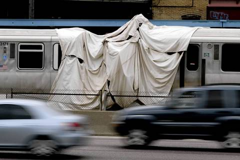 A tarp covers the point of impact of the train collision that happened September 30th in Forest Park. National Transportation Safety Board investigators and CTA officials are trying to determine the cause of an out of service CTA train ramming into a train stopped at a Blue Line station in Forest Park.