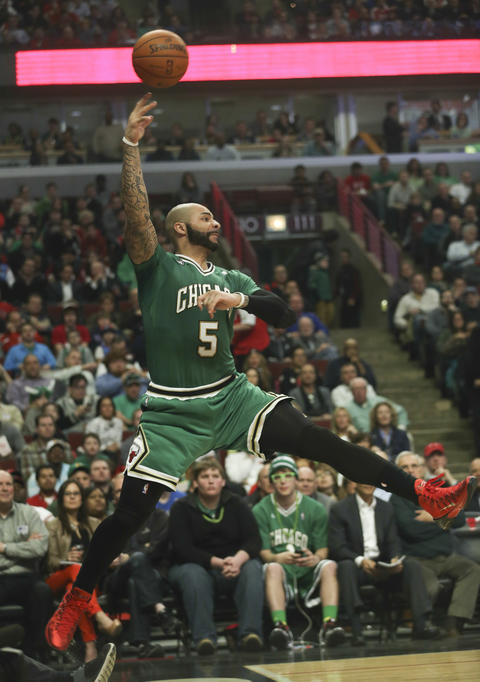 Carlos Boozer saves a ball from going out of bounds.