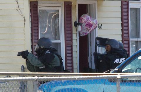 Hampton police dept Swat Team responds to a barricaded suspect at 413 walnut street monday morning. The team has been at the scence since around 11pm sunday evening.
