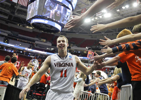 Virginia's Evan Nolte gets high fives from fans following the Cavalier's win over Coastal Carolina during the second round of the NCAA tournament in Raleigh on Friday.