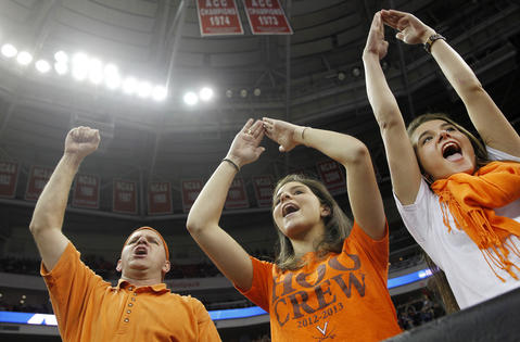 (From left) Poquoson residents Brian, Courtney and Laura Killough cheer prior to Sunday's third round NCAA tournament game between Virginia and Memphis.