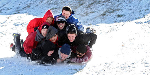 Friends David Miller, Robert Hargrave, Derek Pearson, Weldon Perry, Andrew Mortensen, Marcus Wakelyn, Matt Wakelyn, David Hudson and Colin Mandrick combine two sleds to go down a hill in Yorktown Wednesday.