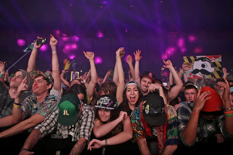 Crowds of people dance as Bassnectar performs at the Hampton Coliseum Friday evening. Bassnectar headlined the sold out show with Pretty Lights.
