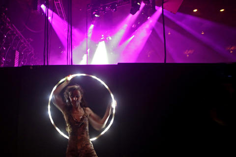 A dancer performs with a glowing hula hoops Pretty Lights performs at the Hampton Coliseum Friday evening. Pretty Lights headlined the sold out show with Bassnectar.