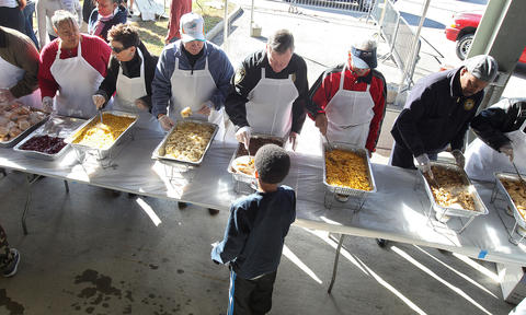 Local politicians and leaders serve a Thanksgiving dinner during the annual Feeding 5000 event at the Newport News Farmers Market. Council members Joseph Whitaker and Tina Vick, as well as Newport News acting police chief Joseph Moore, and others were on hand to serve the meal. No Mags, No Sales, No Internet, No TV