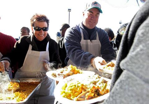 Newport News school superintendant Ashby Kilgore and Newport News police captain Keith Hartman serve Thanksgiving meals at the annual Feeding 5000 holiday event. No Mags, No Sales, No Internet, No TV
